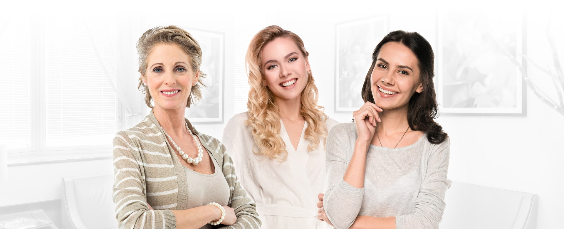 Three women smiling facing forward