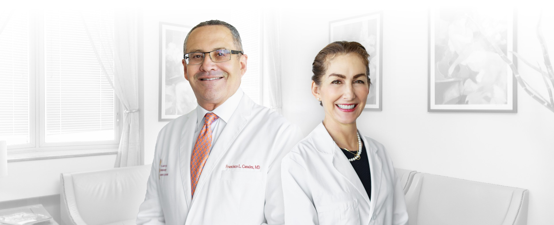 Dr. Canales and Dr. Furnas in white coats